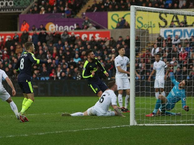 Arsenal routs Swansea 4-0 to go third in Premier League