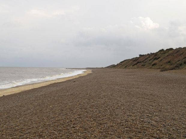Man dead after part of cliff collapses onto a beach in Suffolk