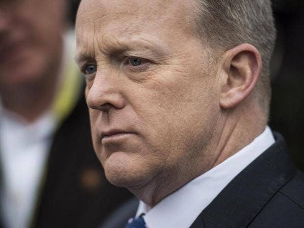 Spicer Fixes Upside-Down Flag Pin To Laughs About 'Distress Call'