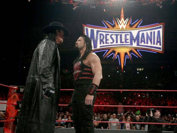 the undertaker appeared to challenge roman reigns to a wrestlemania showdown wwe