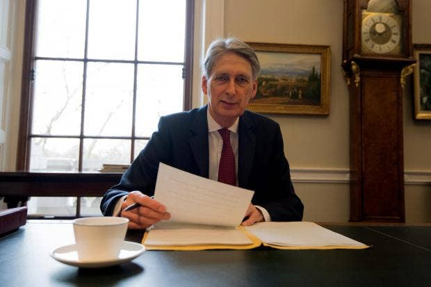 Joker Philip Hammond has a laugh with key Tory manifesto pledge