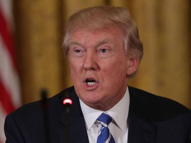 Trump issues revised travel ban for majority Muslim countries