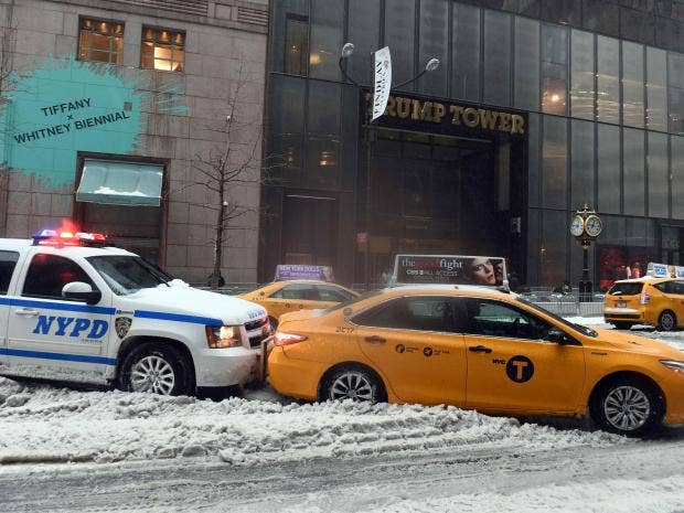 Winter storm stella could cost lives as powerful winds and 2ft a police car pushes a cab stuck on a snow and sleet covered street in new york afp fandeluxe Gallery