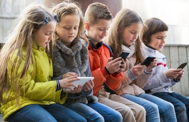 France to bring in total ban on pupils using mobile phones ...