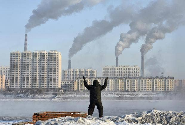 World must hit zero carbon emissions well before 2040 scientists an elderly man exercises on the banks of the songhua river in jilin china as smoke billows from huge chimneys reuters publicscrutiny Choice Image