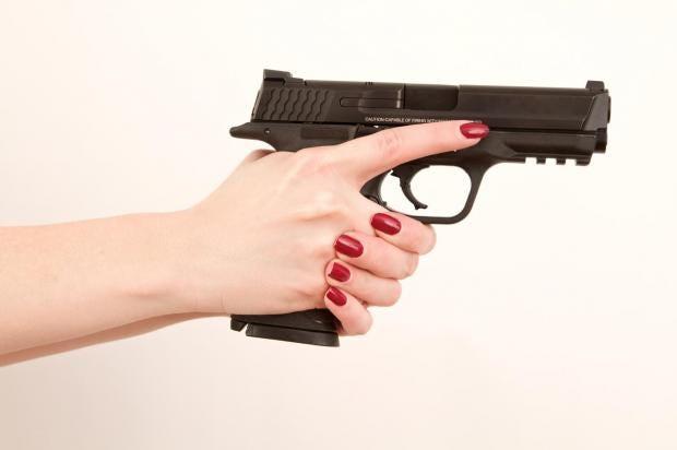 woman-holding-gun.jpg