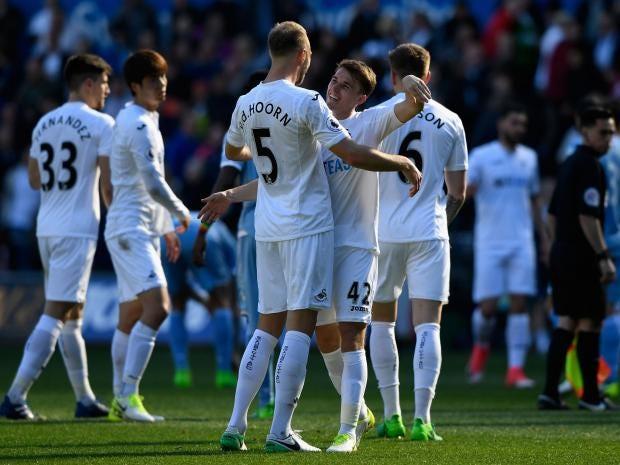 Swansea improve survival hopes with Premier League win over Stoke