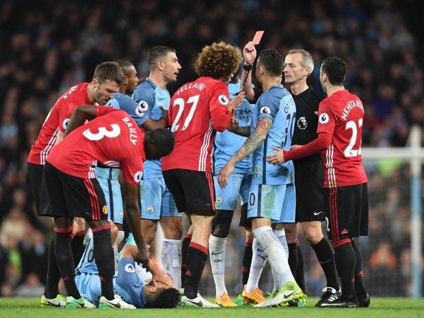 Fellaini sent off but United holds City to a goalless draw