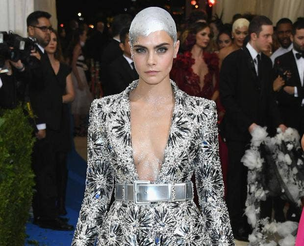 Cara Delevingne rallies against mainstream beauty standards with shaved head at the Met Gala