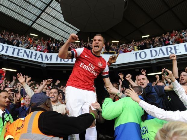 lukas podolski celebrates with arsenal fans