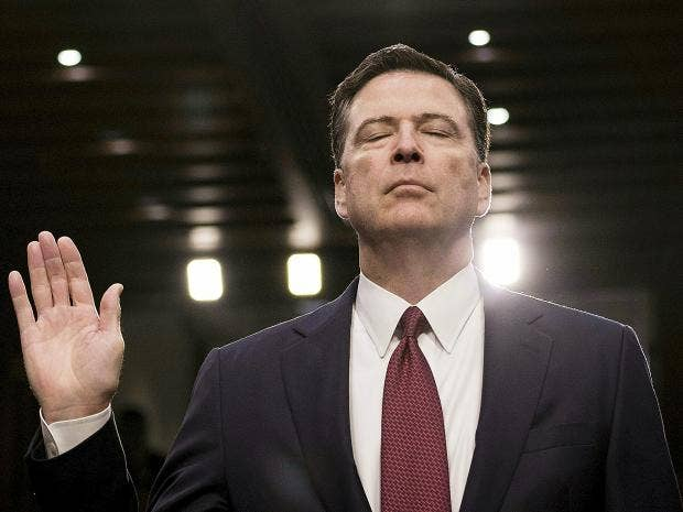 Former FBI director James Comey is sworn in during a hearing before the  Senate Select Committee on Intelligence on Capitol Hill in Washington, ...