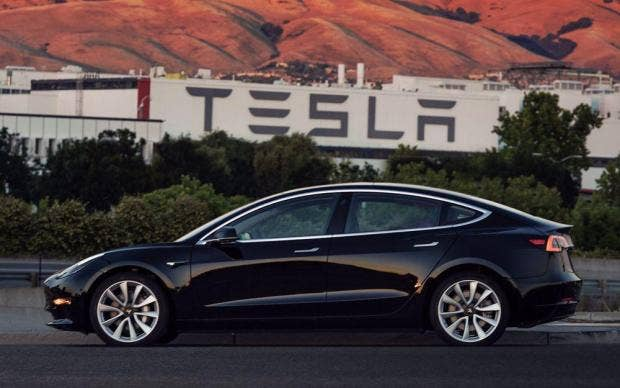 Tesla Model Ceo Elon Musk Gets First Electric Car As Production