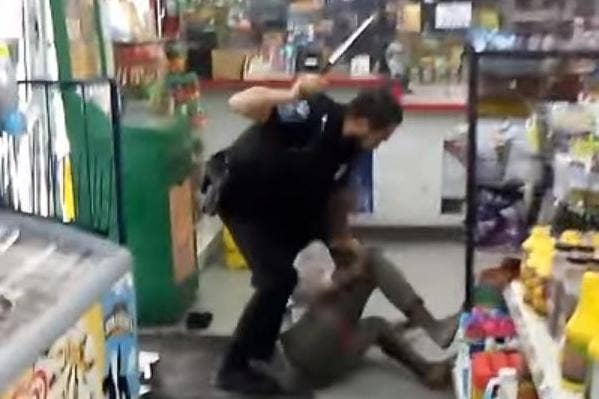 Police officer filmed beating homeless woman with baton 'after she begs for  money'