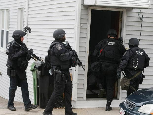 swat team members enter a residential building in similar type of police showed up at the reeves home on heartbroken man whose parents called over suicide fears officer tr