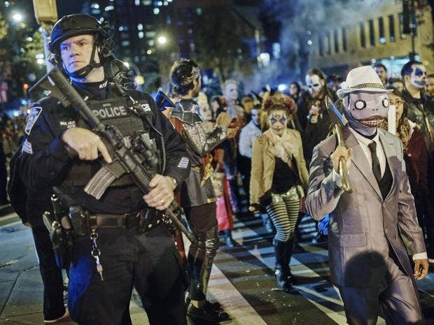 Defiant New Yorkers take to streets for Halloween parade hours ...