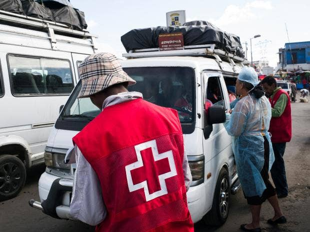 Red Cross workers in Antananarivo, Madagascar, where the plague has spread  Getty