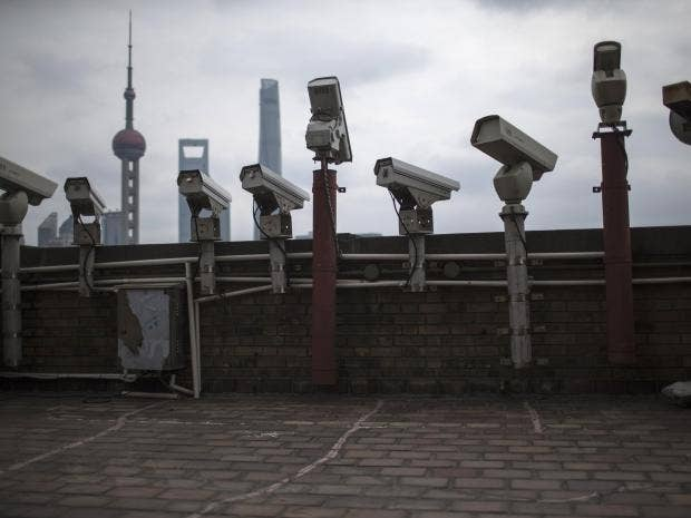 Security cameras are seen on a building in Shanghai Reuters