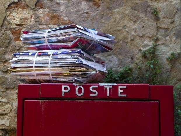 Postman arrested after storing mail in his house for three years ... The Independent A stack of letters atop a postbox in Italy, where police have arrested a postal worker over 400kg of undelivered mail Rex Features