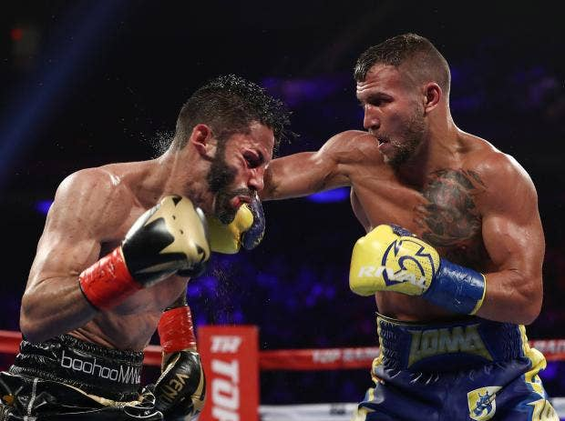 Image result for Vasyl LomachenkoMakes boxing history; Claims World Title in a Third Weight Division 12th Professional Fight.