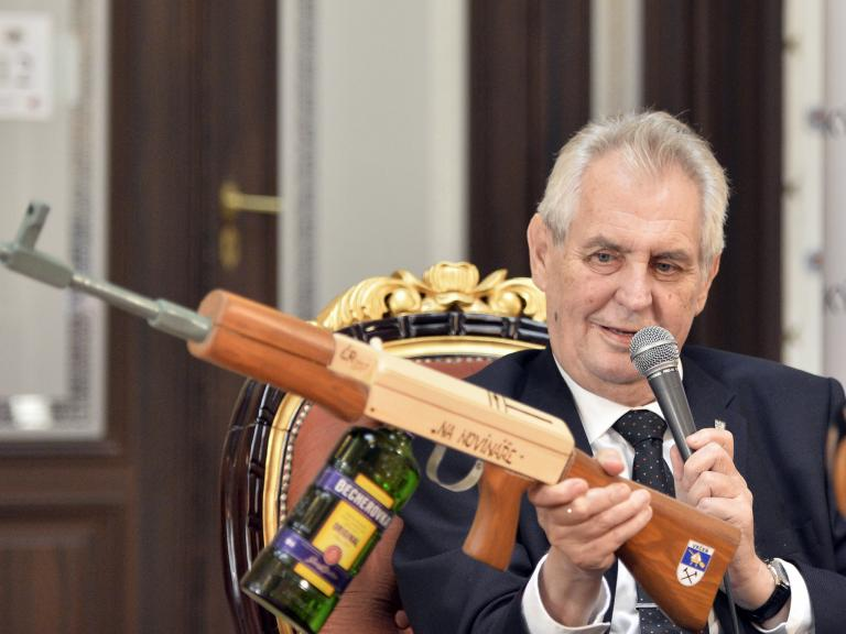 Czech President holds up replica Ak-47 marked 'for journalists' in press conference