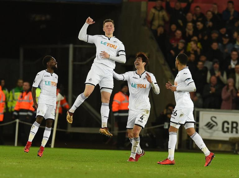 Alfie Mawson's opportunistic strike hands Swansea crucial points to dent Liverpool's top-four ambitions