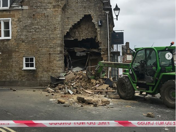 Thieves leave hole in the wall after using stolen tractor to rip out cash machine from listed building