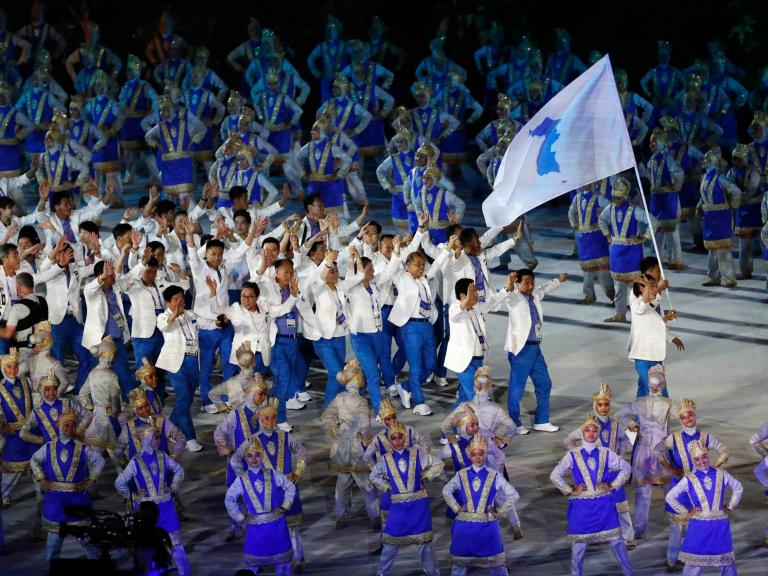 Unified Korean athletes cheered by thousands as they parade together at Asian Games opening ceremony