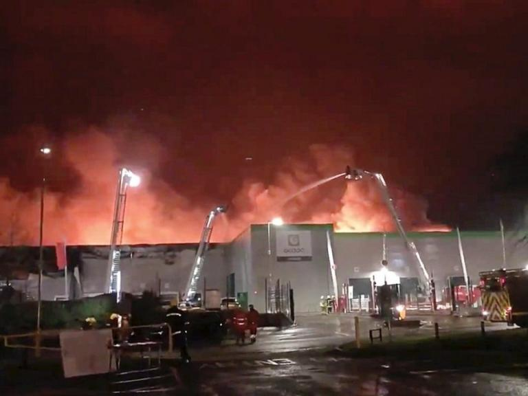 Ocado slumps to £215m losses after fire destroys robot warehouse