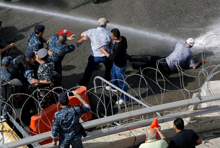 Lebanon security forces blast anti-austerity protestors with water cannons