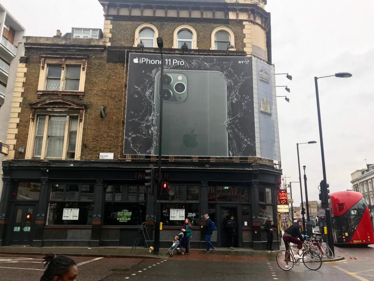 Night mode: Giant iPhone advert blocking out daylight to poverty-hit families in London apartment bl ...
