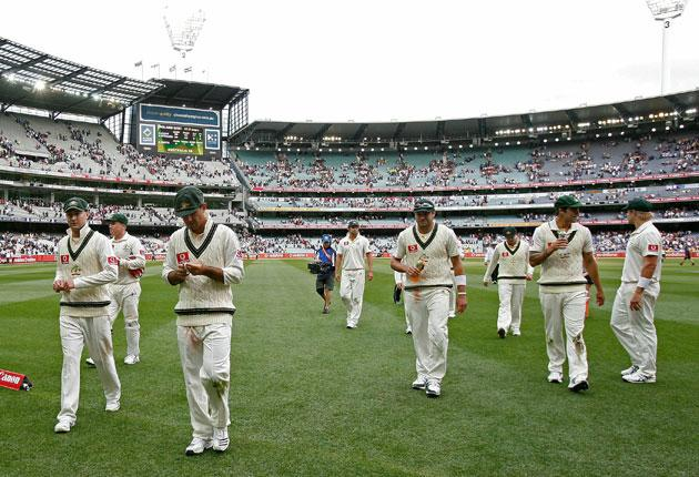 Skipper Ricky Ponting leads his Australian team off at the end of a disastrous day in Melbourne