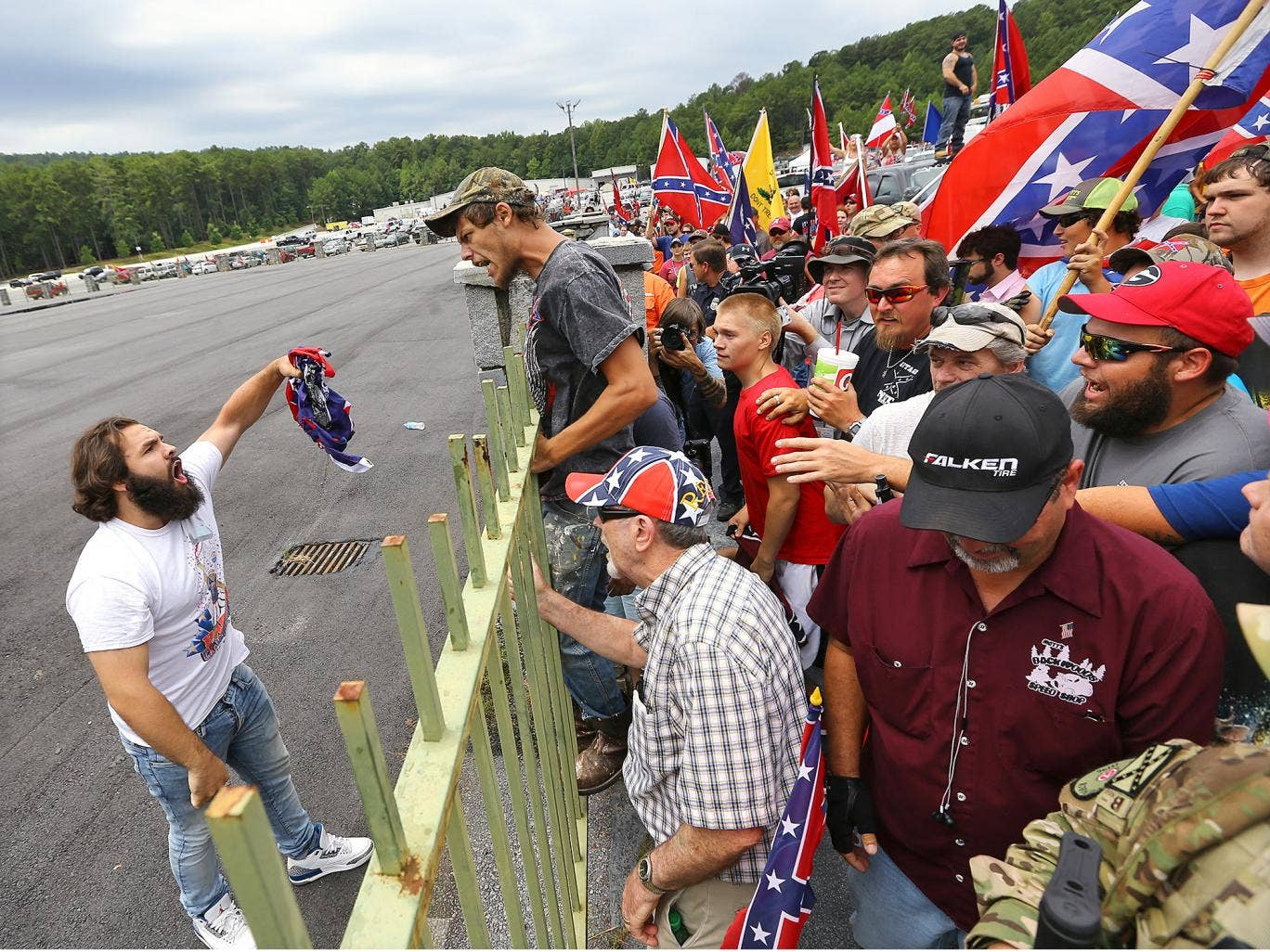 Tensions Flare As Confederate Flag Supporter Reaches For