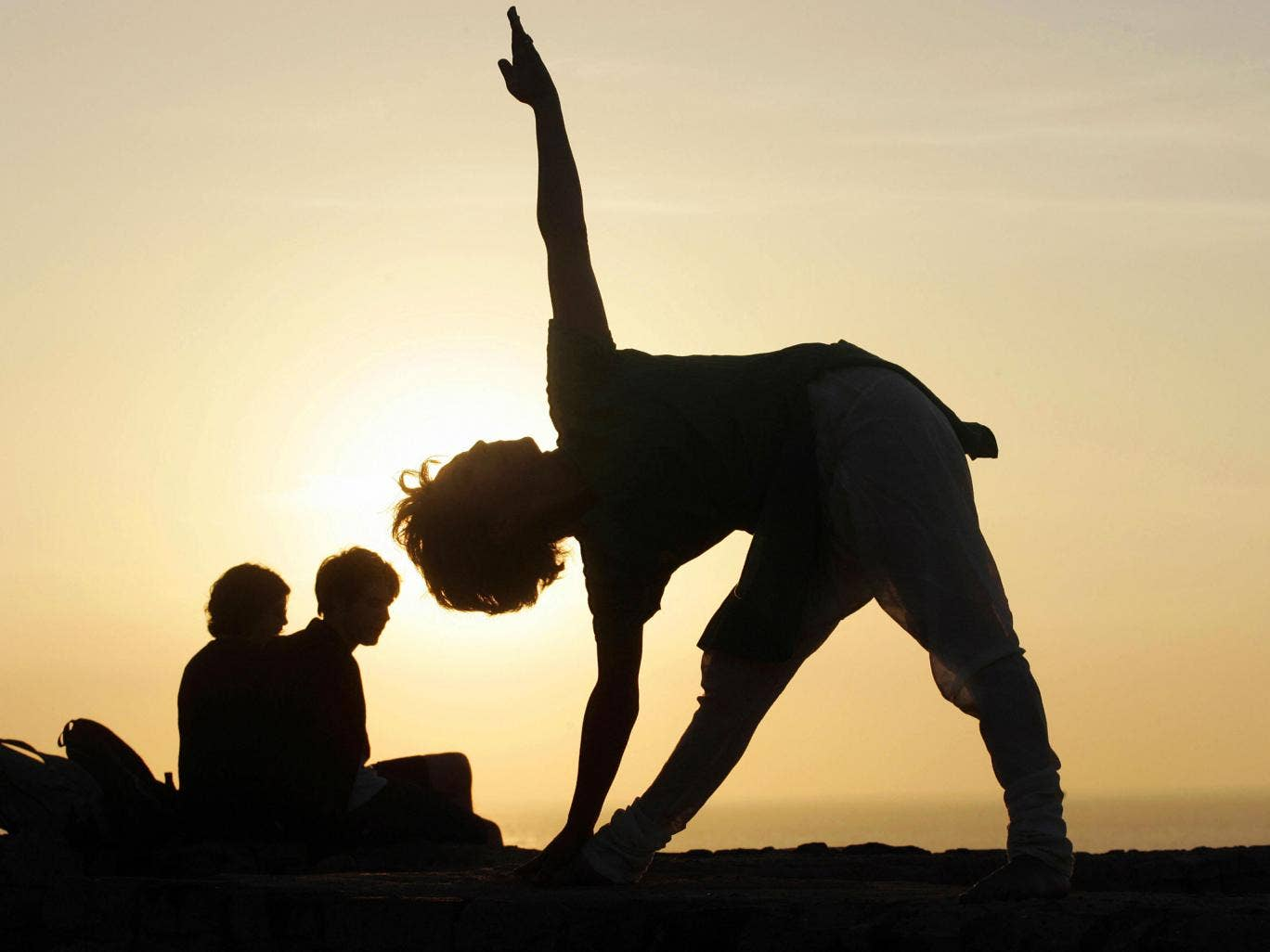 Yoga is practiced by millions of people around the world Getty Images