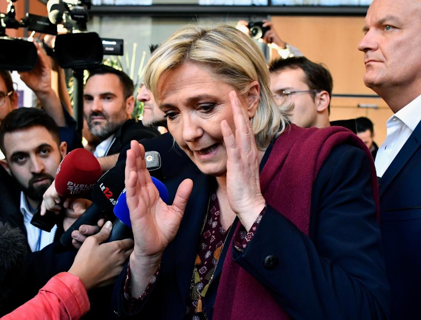 FEMEN bare in front of Marine Le Pen
