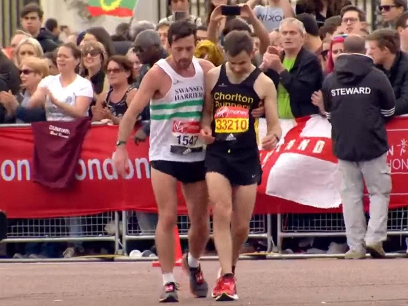 London Marathon Runner Stops Just Short Of Finish To Help Ailing Rival