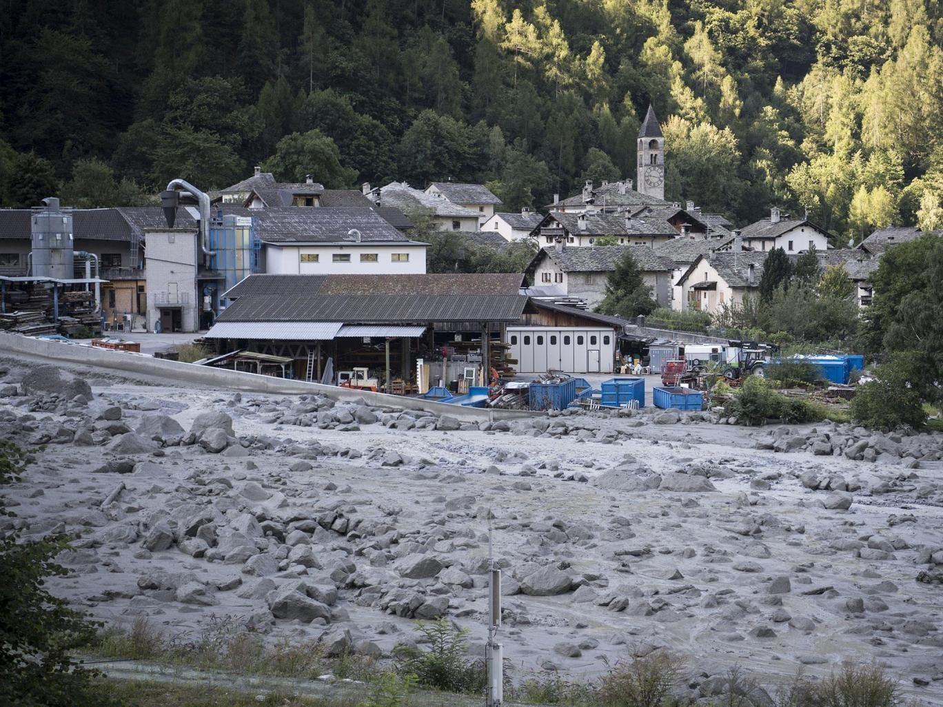 A view of a landslide and the village Bondo in Graubuenden in southeast Switzerland EPA/GIAN EHRENZELLER