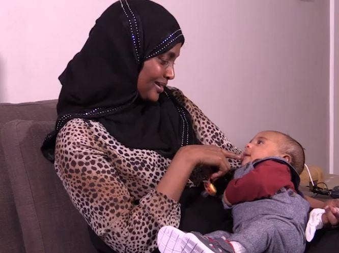 Grenfell Tower fire survivor Maryam Adam and her son Mohammed (screen grab) Daily Mirror