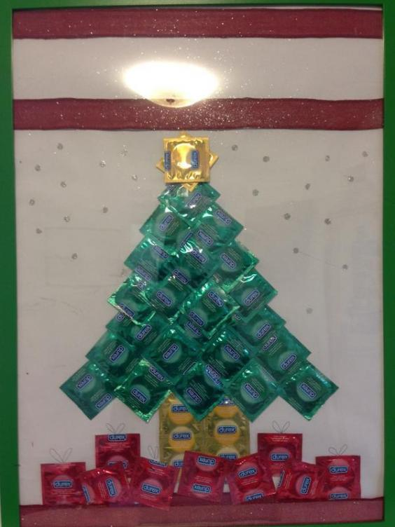 people are getting really really upset over this condom christmas tree - Christmas Condoms
