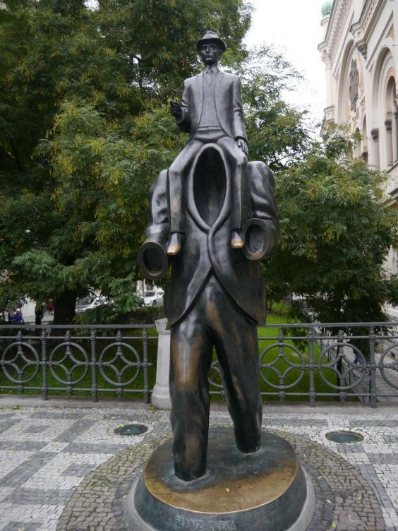 Statue of a naked boy in Prague, Czech Republic. - Stock