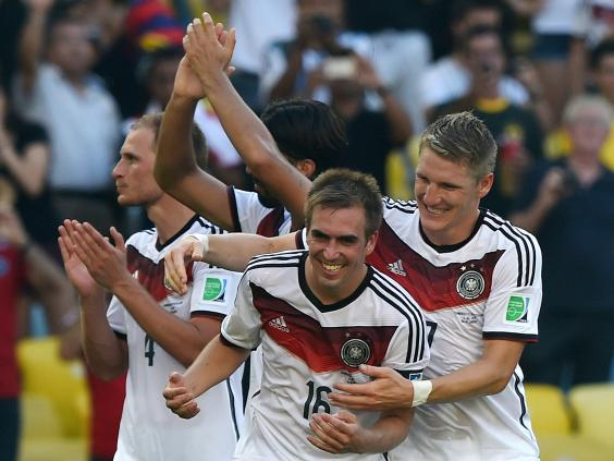 Germany's-defender-and-captain-Philipp-Lahm-(C)-and-Germany's-midfielder-Bastian-Schweinsteiger-(R)-celebrate-after-winning-the-quarter-final-football-match-between-France.jpg