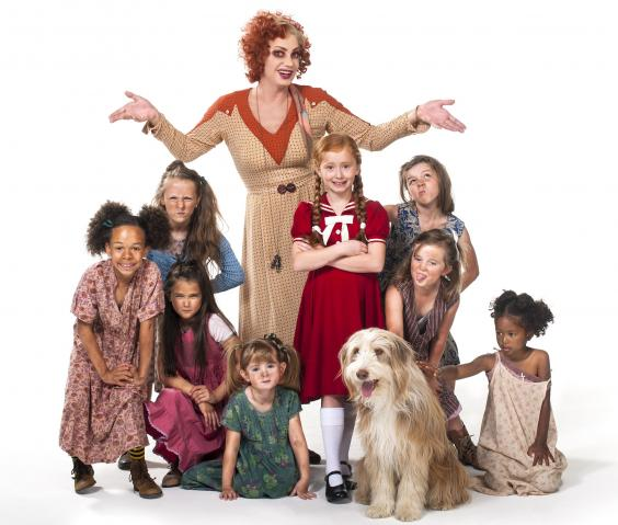 ANNIE - Craig Revel Horwood as Miss Hannigan with Annie and orphans - Photo credit Hugo Glendinning.jpg