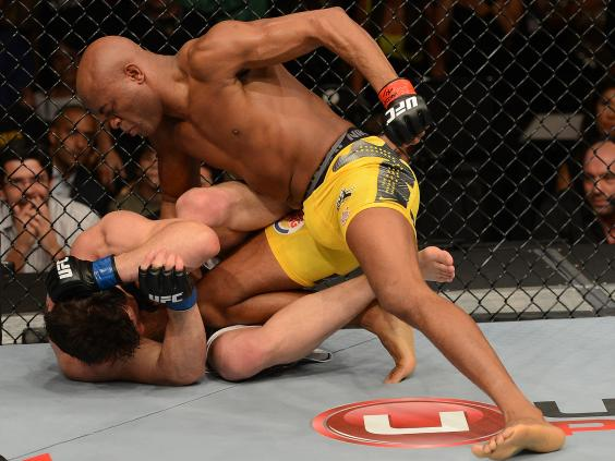 Anderson-Silva-punches-Chael-Sonnen-during-their-UFC-middleweight-championship-bout---Donald-Miralle-Zuffa-LLC.jpg