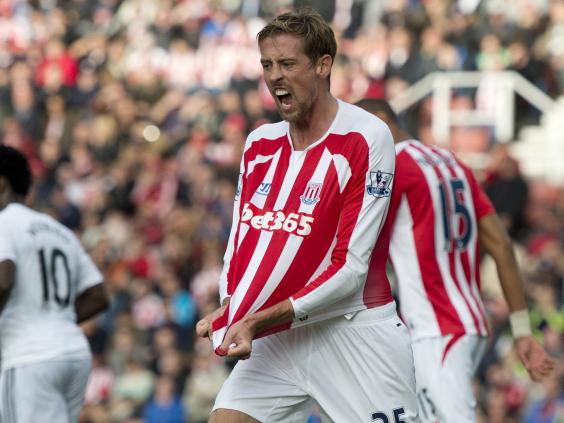 Peter-Crouch-complains-about-shirt-pulling-during-the-English-Premier-League-football-match-between-Stoke-City-and-Swansea-City.jpg