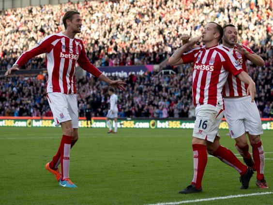 Stoke-City's-Scottish-midfielder-Charlie-Adam-(C)-celebrates-scoring-a-penalty.jpg