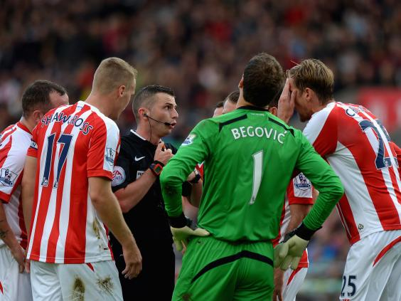 Stoke-City-players-surround-Referee-Michael-Oliver-after-he-awarded-Swansea-City-a-penalty.jpg
