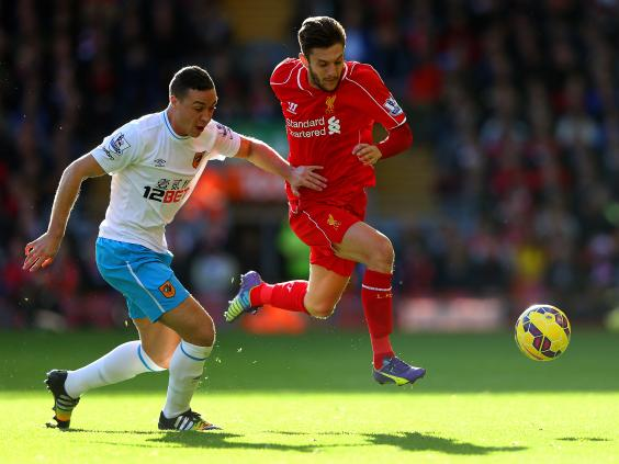 Adam-Lallana-of-Liverpool-battles-for-the-ball-with-James-Chester.jpg