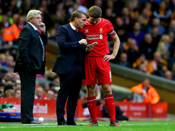 Brendan-Rodgers,-manager-of-Liverpool-speaks-with-his-captain-Steven-Gerrard-as-Steve-Bruce-manager-of-Hull-City-looks-on.jpg