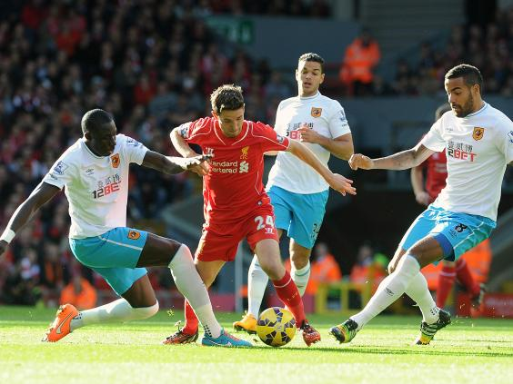 Joe-Allen-of-Liverpool-runs-through-the-Hull-players.jpg