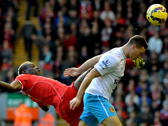 Liverpool's-Italian-forward-Mario-Balotelli-(L)-vies-for-the-ball-with-with-Hull-City's-English-defender-James-Chester.jpg