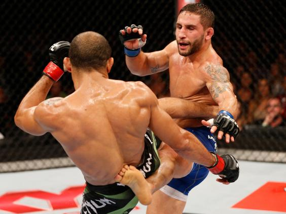 Chad-Mendes-and-Jose-Aldo-trade-kicks-during-UFC-179.jpg
